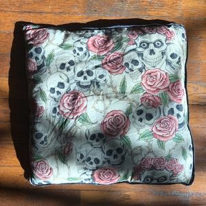 Skull and rose patterned pillow